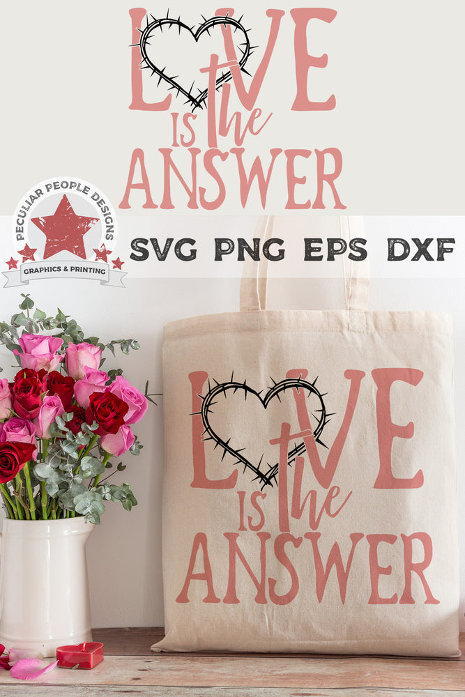 love is the answer svg printed on a tote bag set next to a bouquet of roses