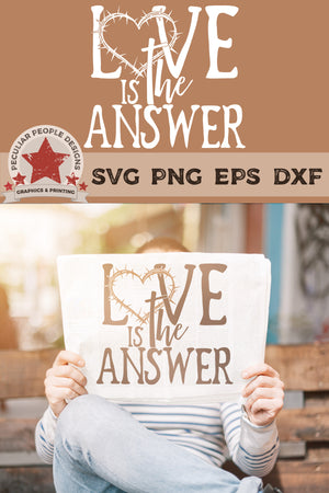 Load image into Gallery viewer, a man outside, relaxed on a bench, holding up a paper with love is the answer svg printed on the front page