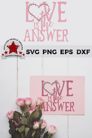 Load image into Gallery viewer, love is the answer svg embossed on a greetig card, laying under a bunch of pink roses