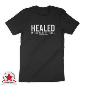 "a black unisex tee with a text design in white, reading ""healed in the name of Jesus, Isaiah 53 five"""