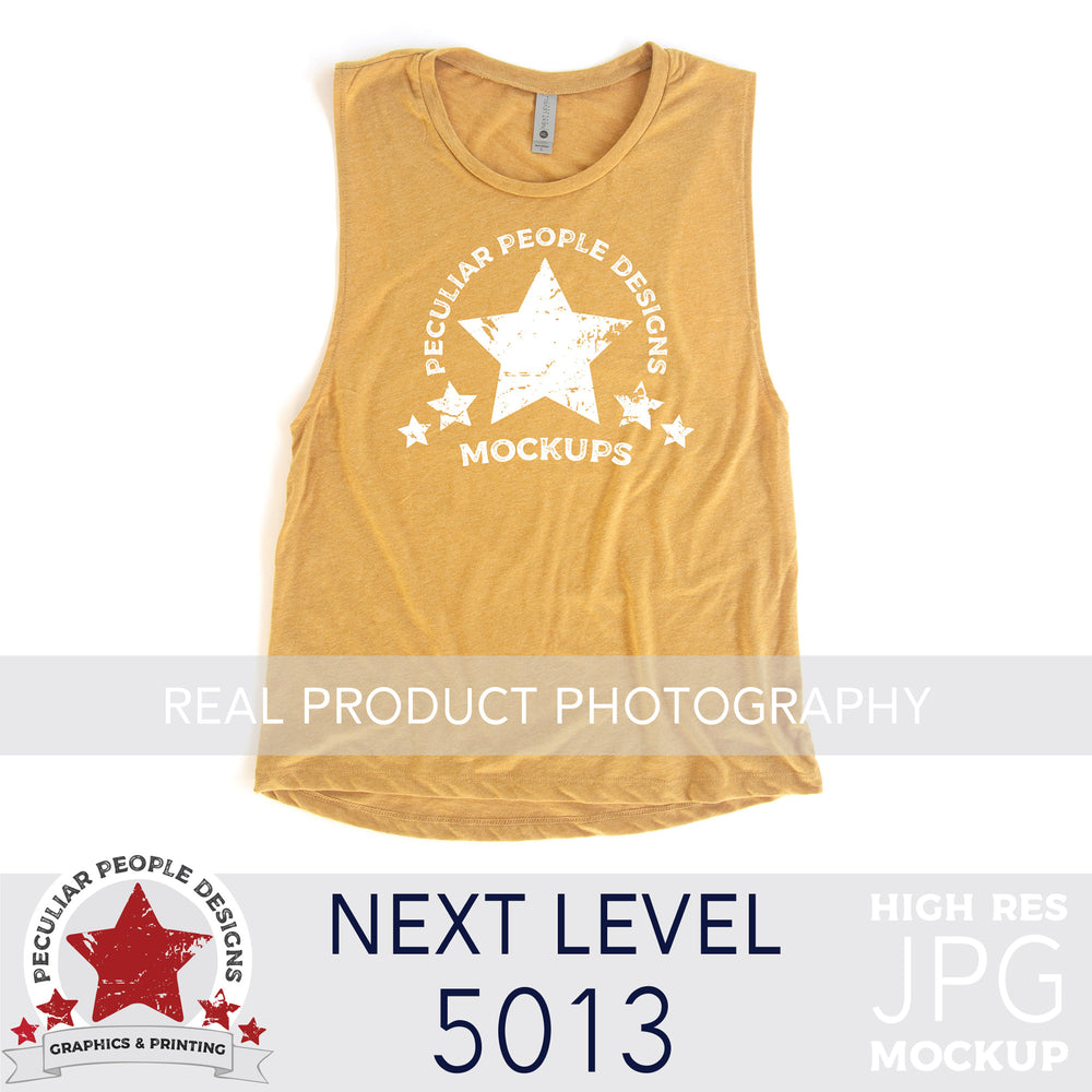 an antique gold, next level 5013 muscle tank flat lay mockup with a white background by peculiar people designs