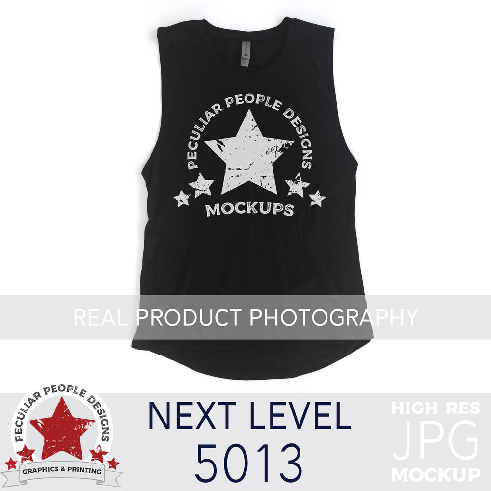a Black, next level 5013 muscle tank flat lay mockup with a white background by peculiar people designs