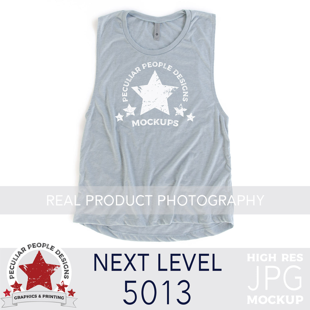 a Stonewash Blue, next level 5013 muscle tank flat lay mockup with a white background by peculiar people designs