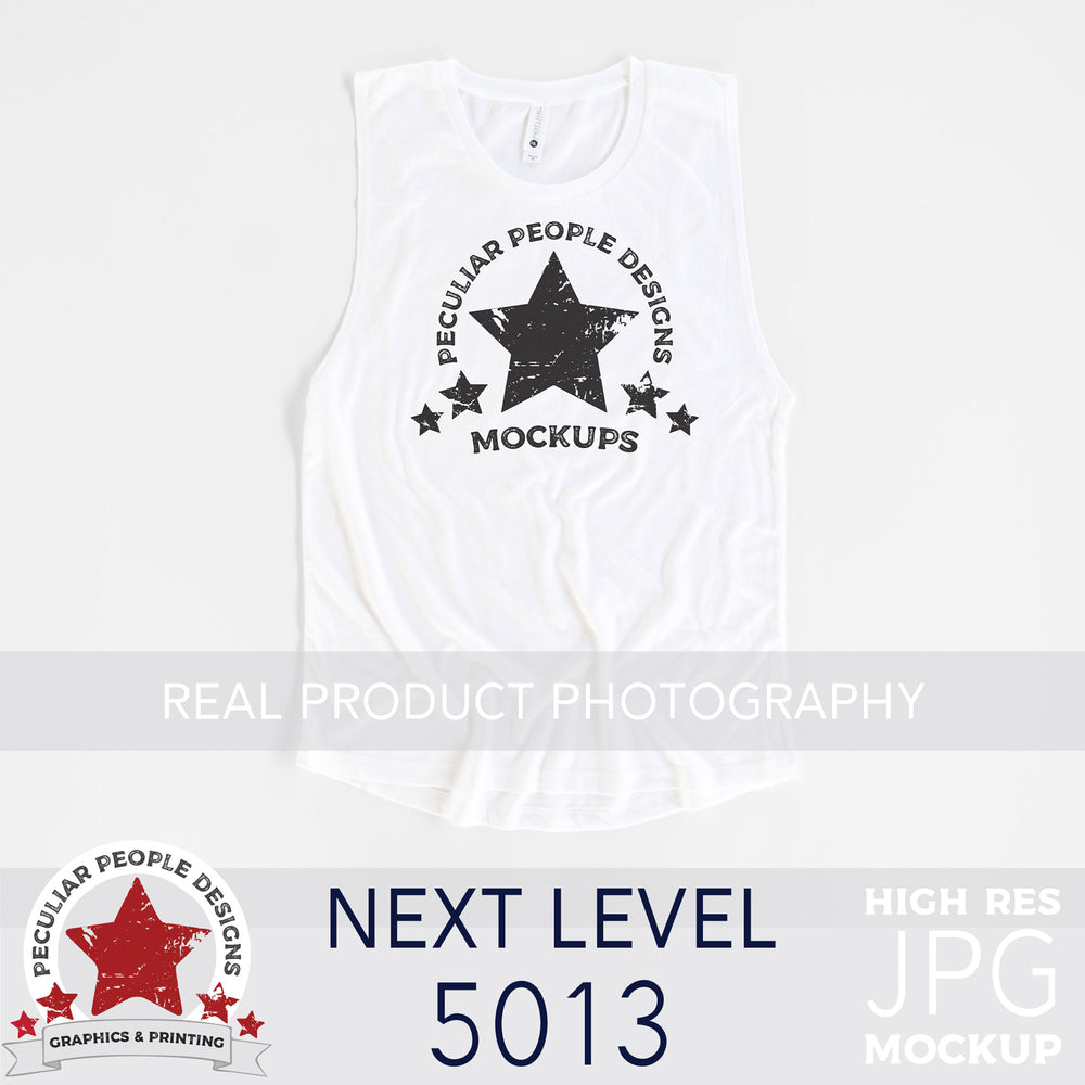 a White, next level 5013 festival muscle tank flat lay mockup with a grey background by peculiar people designs