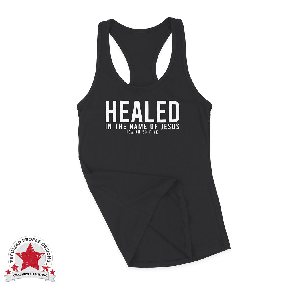 "a black racerback tank with a text design in white, reading ""Healed in the name of Jesus, Isaiah 53:5"""