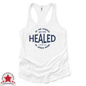 "a white racerback tank with navy graphic, reading ""by his stripes you were healed in Jesus name, 1 Peter 2:24"""