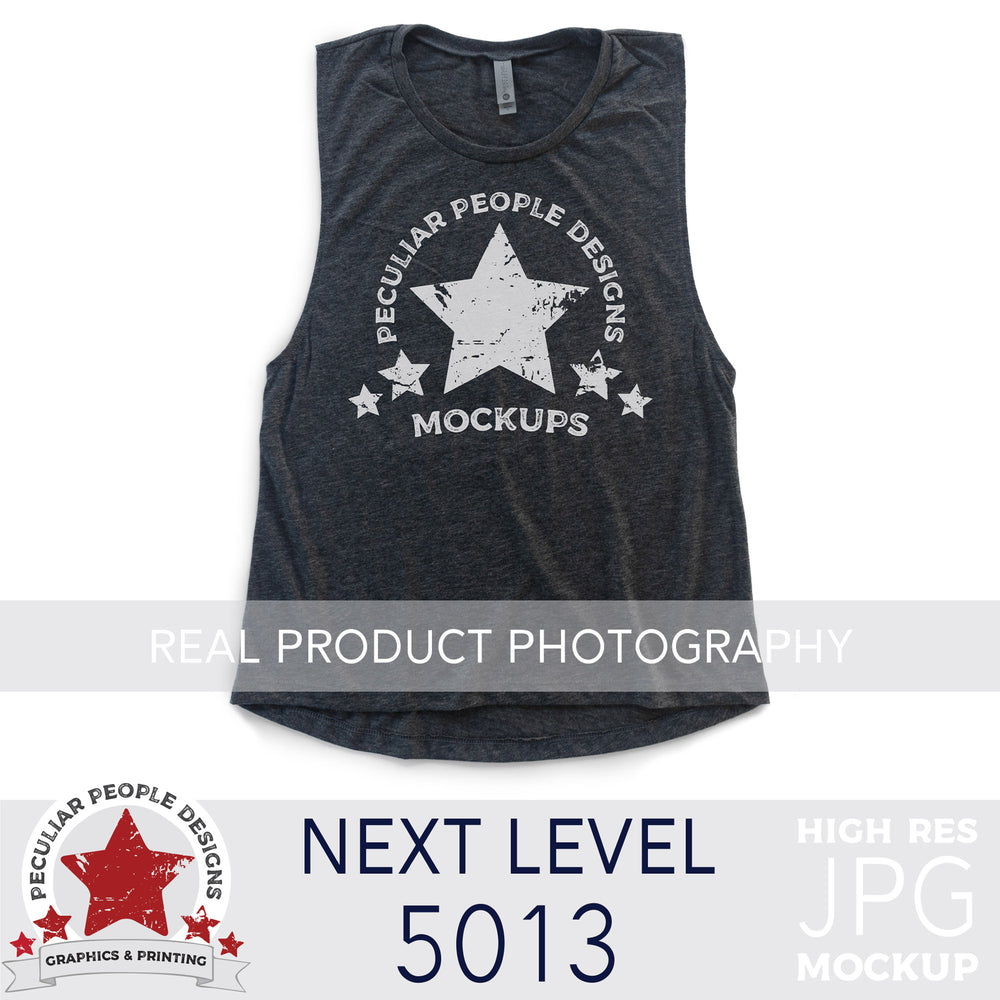 a Vintage Navy, next level 5013 muscle tank flat lay mockup with a white background by peculiar people designs