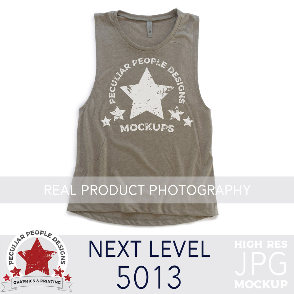 an Ash, next level 5013 muscle tank flat lay mockup with a white background by peculiar people designs