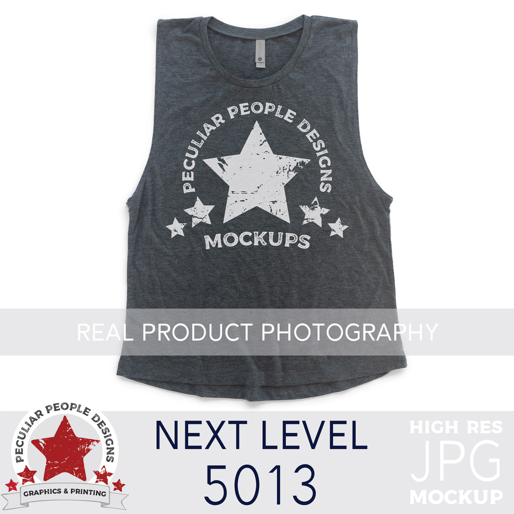 a Charcoal, next level 5013 muscle tank flat lay mockup with a white background by peculiar people designs