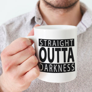 Load image into Gallery viewer, Straight outta darkness svg shown on a white mug, held by a man