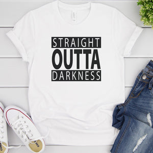 Load image into Gallery viewer, straight outta darkness svg shown on a white tshirt with bluejeans and white converse