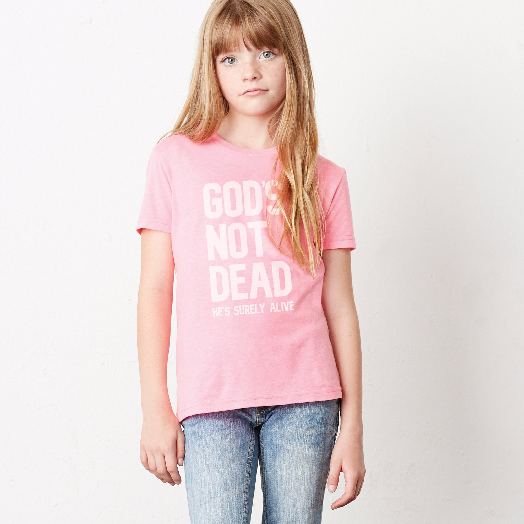 Kids Collection featuring a young girl in a pink Gods Not Dead shirt