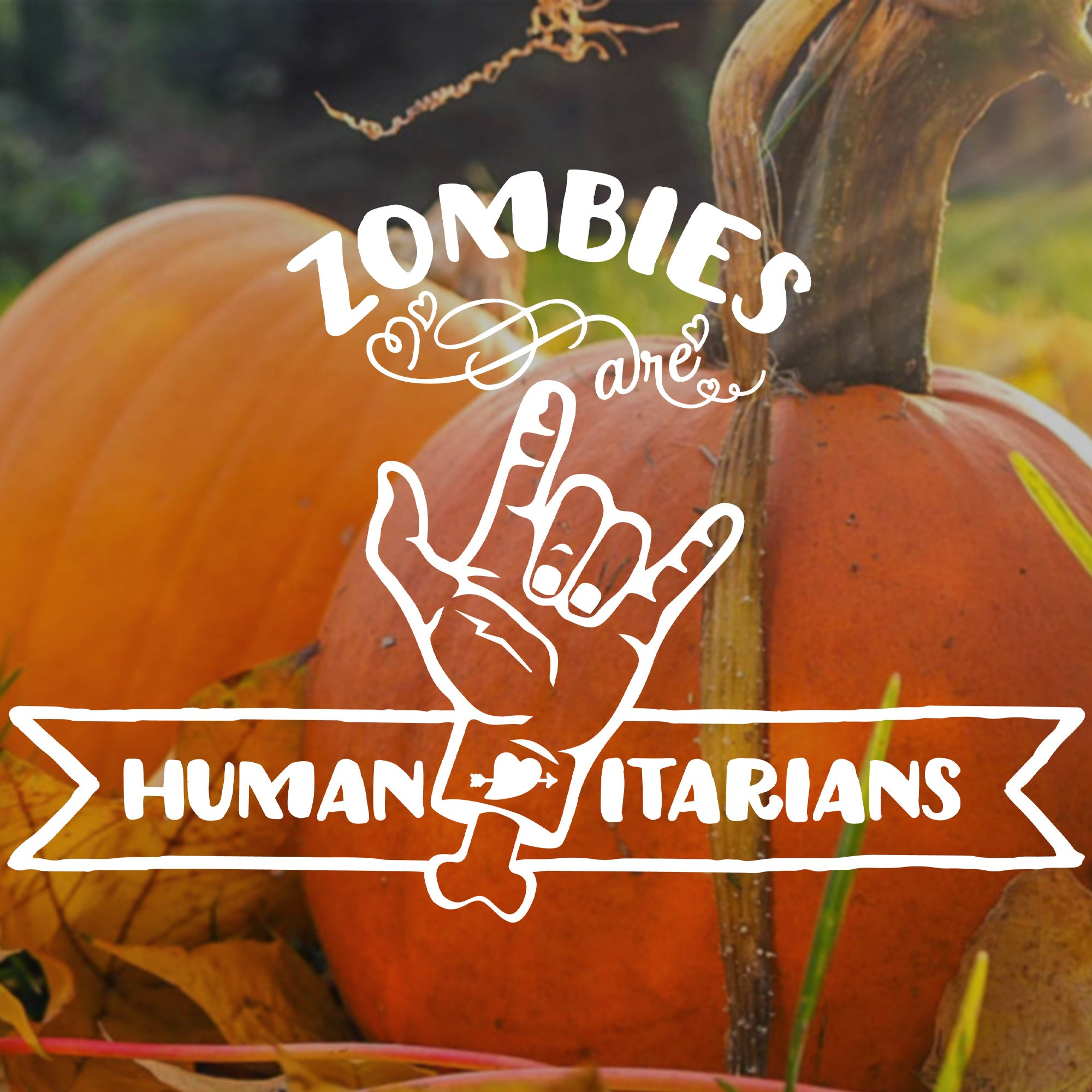 zombies are humanitarians SVG design shown over a close up photo of pumpkins in a Fall field