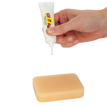 Pop it Pal® Peach Pimple Popping Toy with Refillable Pimple Pus