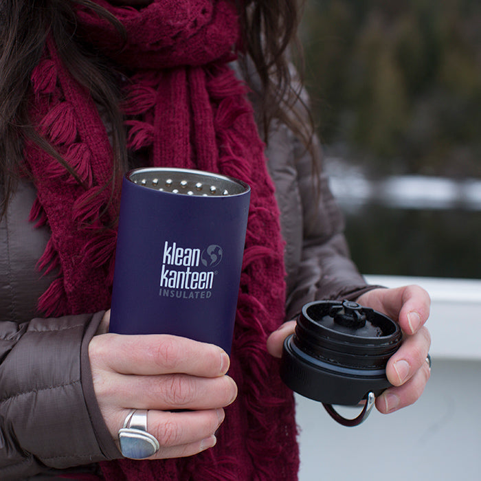 Woman holding Klean Kanteen TKWide with Cafe Cap removed in the city