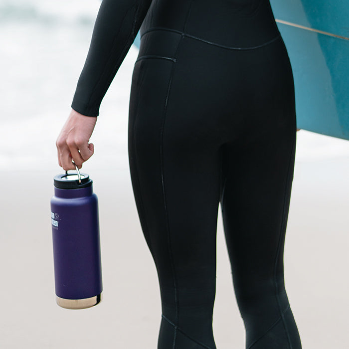 Woman in wet suit holding bottle by Klean Kanteen TKWide Loop Cap