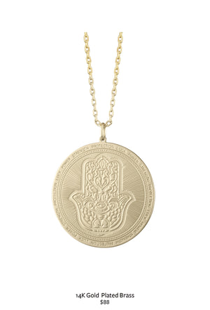 gold chain white a and hamsa pendant