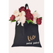 A cotton tote bag personalized for a member of the bridal party