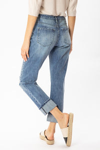 High Rise Destructive Denim With A Cuff