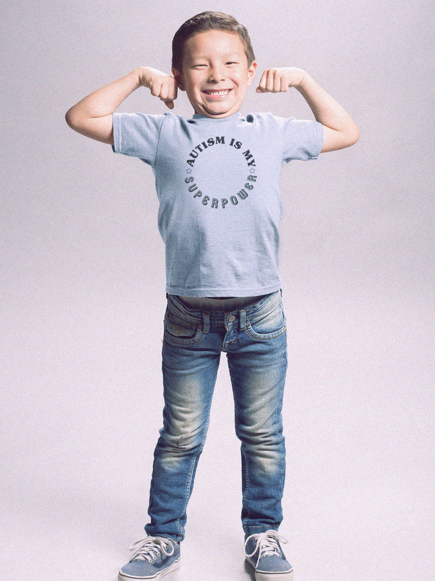 boy flexing wearing autism is my superpower t-shirt