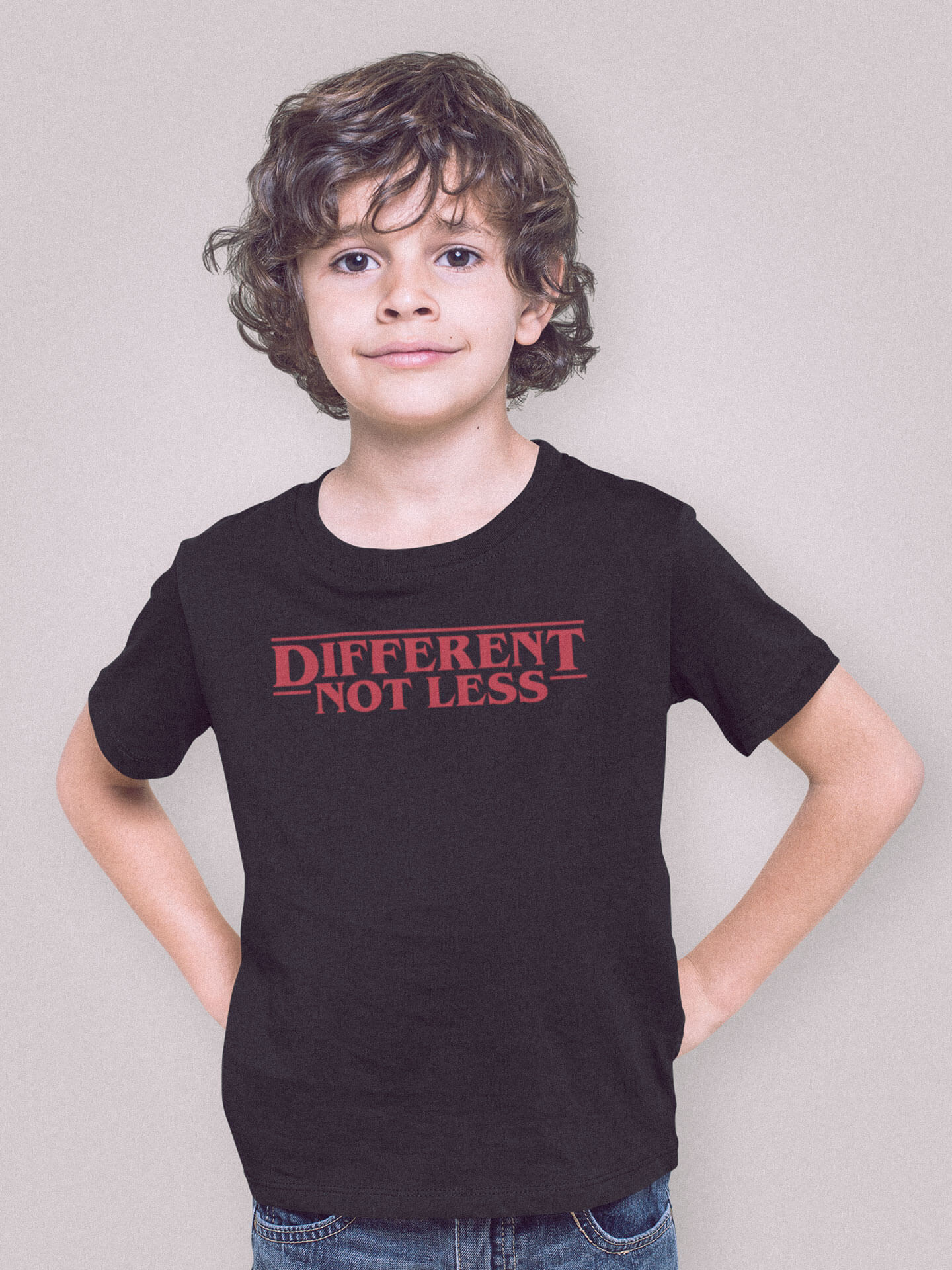 boy posing wearing different not less t-shirt in a studio