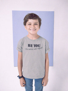 boy wearing be you t-shirt with blue square