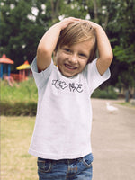 Boy With Hands Behind Head Wearing Love Autism T-Shirt