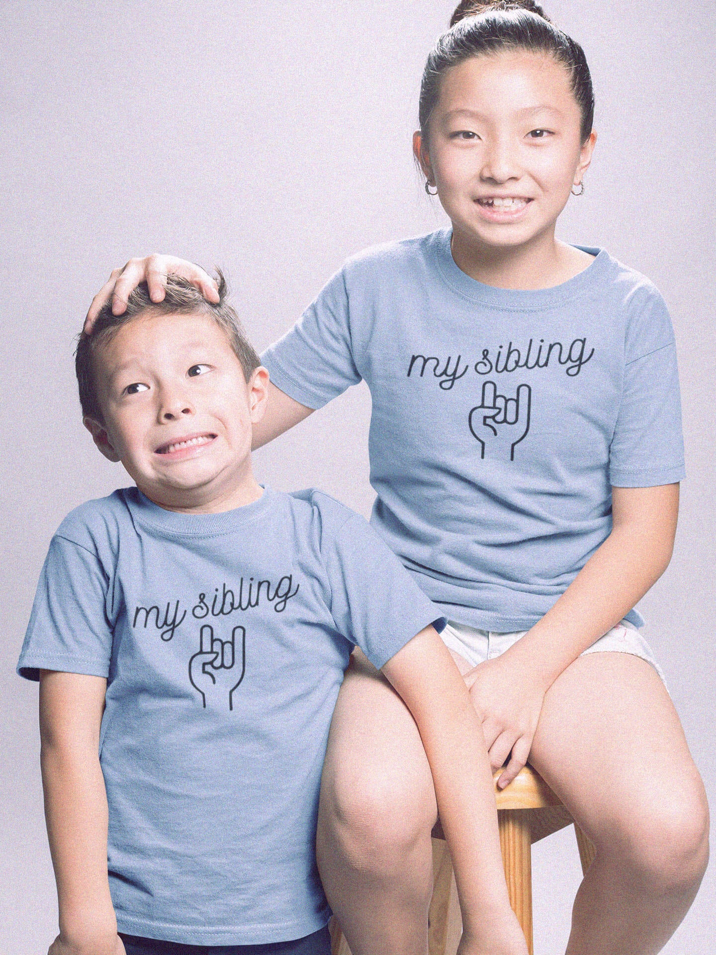 brother and sister wearing my sibling rocks t-shirts