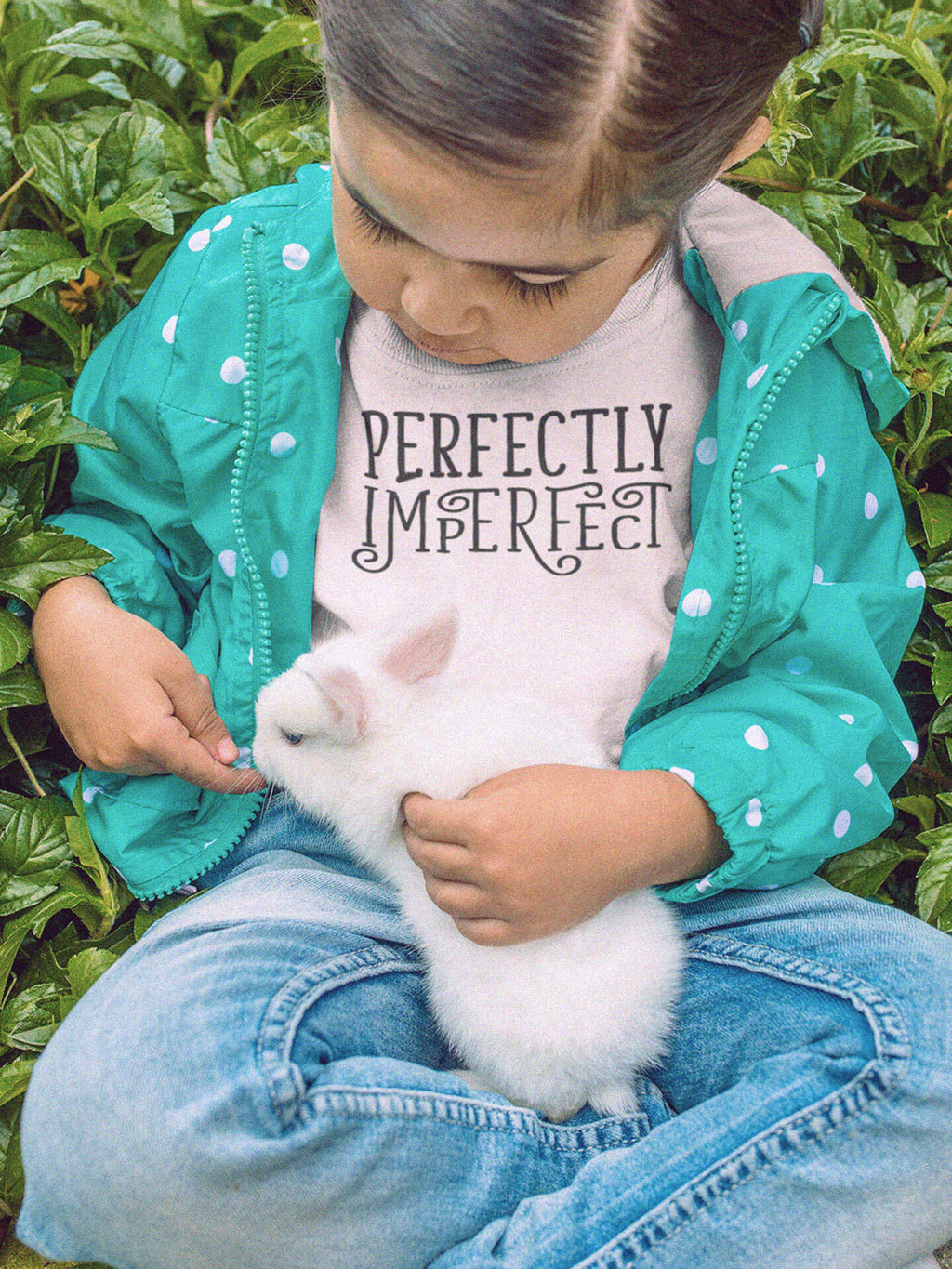 girl petting bunny wearing perfectly imperfect t-shirt