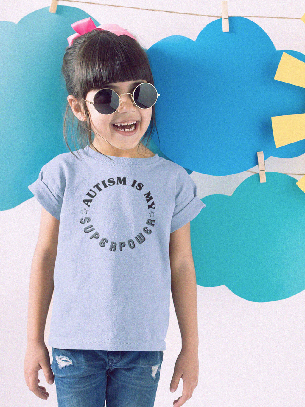 girl wearing autism is my superpower with sunglasses