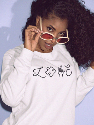 girl wearing autism love sweatshirt with sunglasses