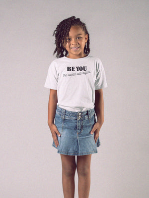 girl wearing be you t-shirt white background