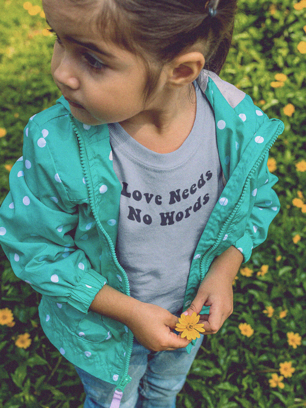 girl with jacket wearing love needs no words t-shirt