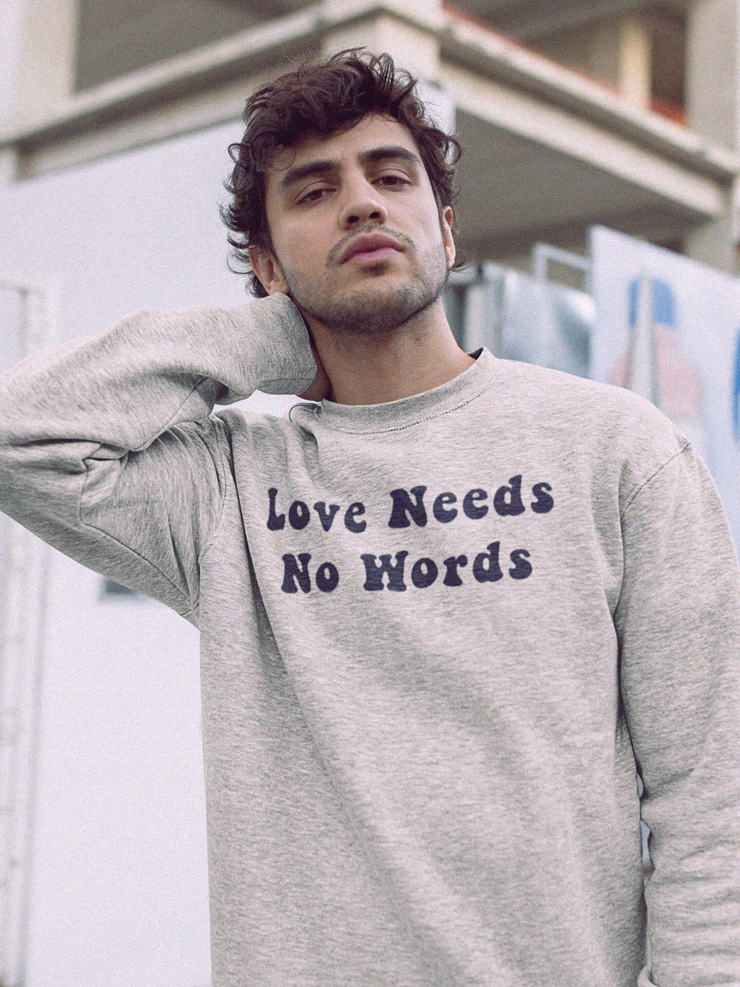man wearing love needs no words sweatshirt