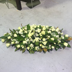 Casket sheaf of fresh flowers for funeral memorial service Melbourne bayside