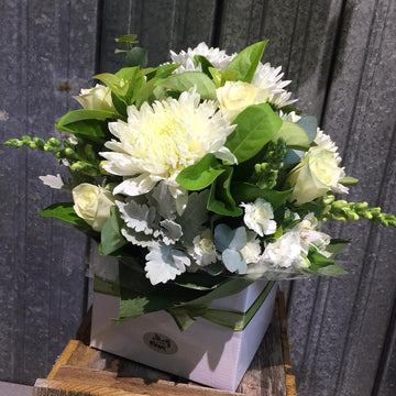 A fresh flower posy in a presentation box.