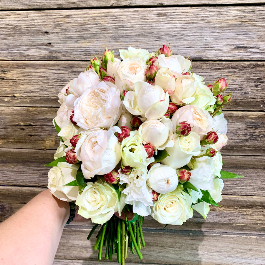 Delicate garden rose bridal bouquet and matching grooms buttonhole.