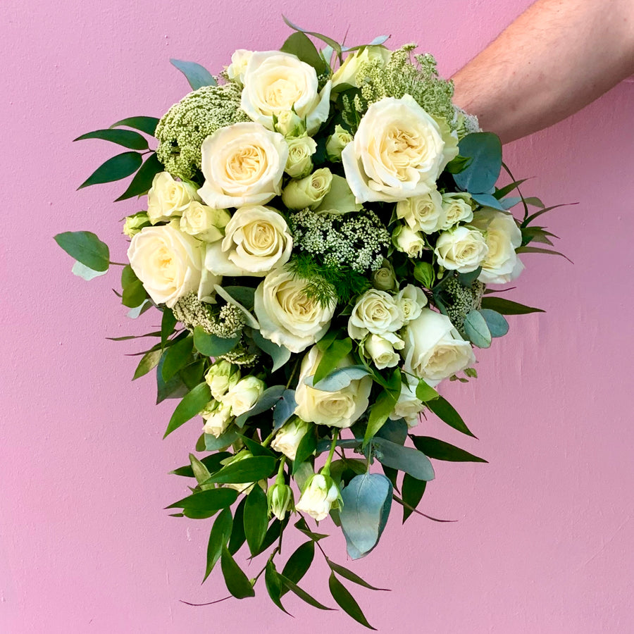Whimsical and cascading bridal bouquet and grooms buttonhole.