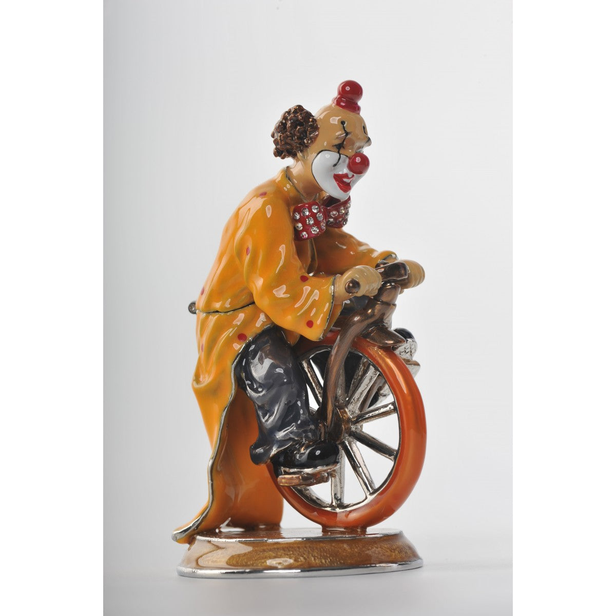 Circus Clown riding the bike by Keren Kopal