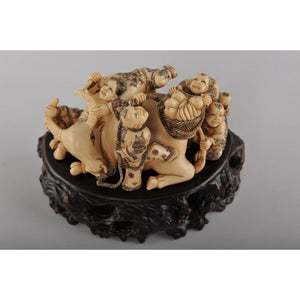 Mammoth Ivory- Kids Playing on a Bull