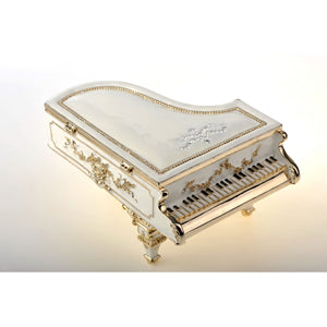 Big white piano with music trinket box