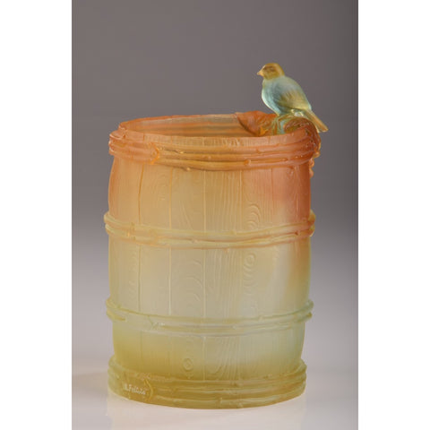 Crystal Bird Resting on Wine Barrel
