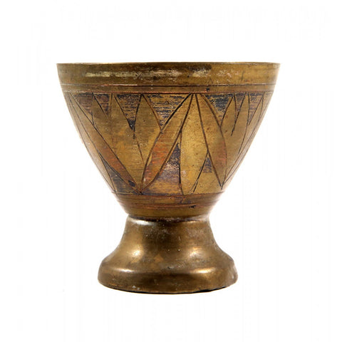 A small brass cup