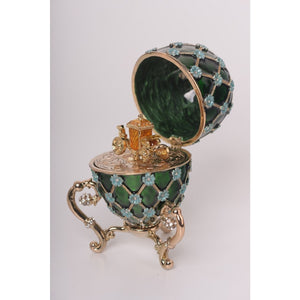 Green Faberge Egg with Gold Carriage Inside by Keren Kopal