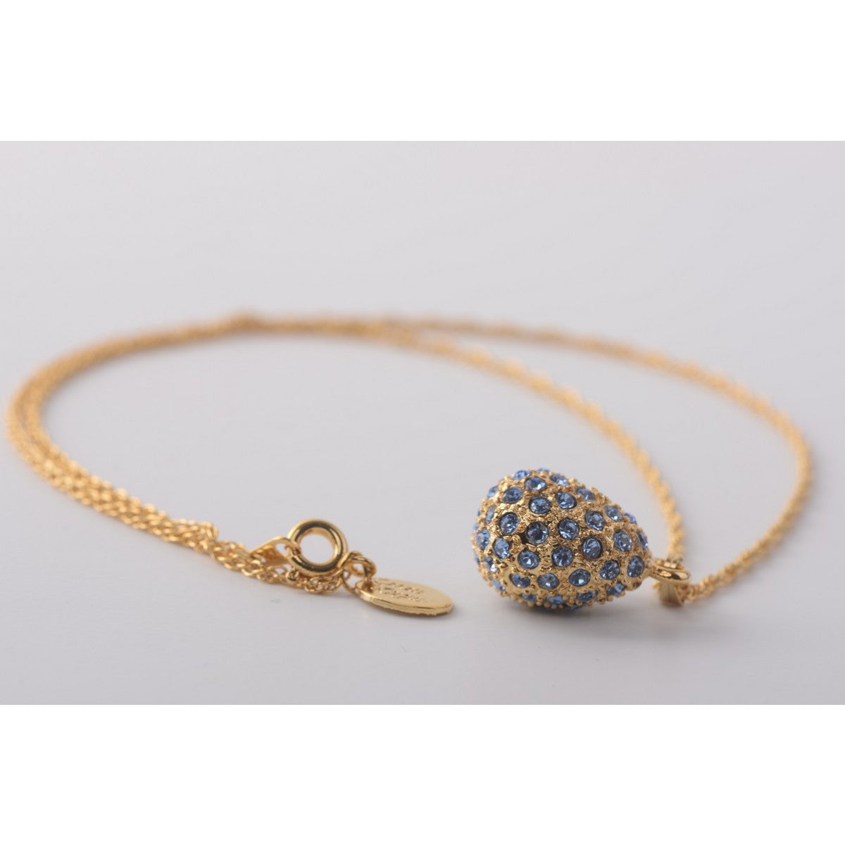 Gold with blue crystals  Faberge Egg Pendant Necklace