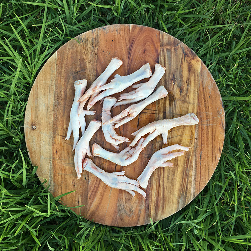 Top View of Chicken feet on wooden board