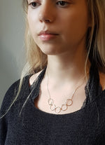 Gold Linked Spheres Necklace