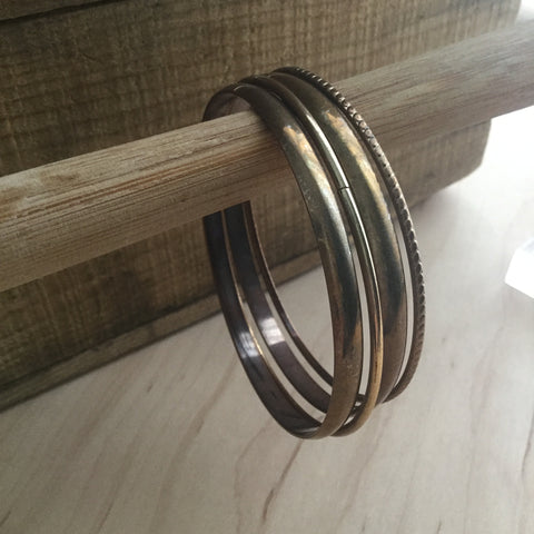 Four bangles, one with a pattern, three plain, metallic  Kitchener, Ontario, Canada