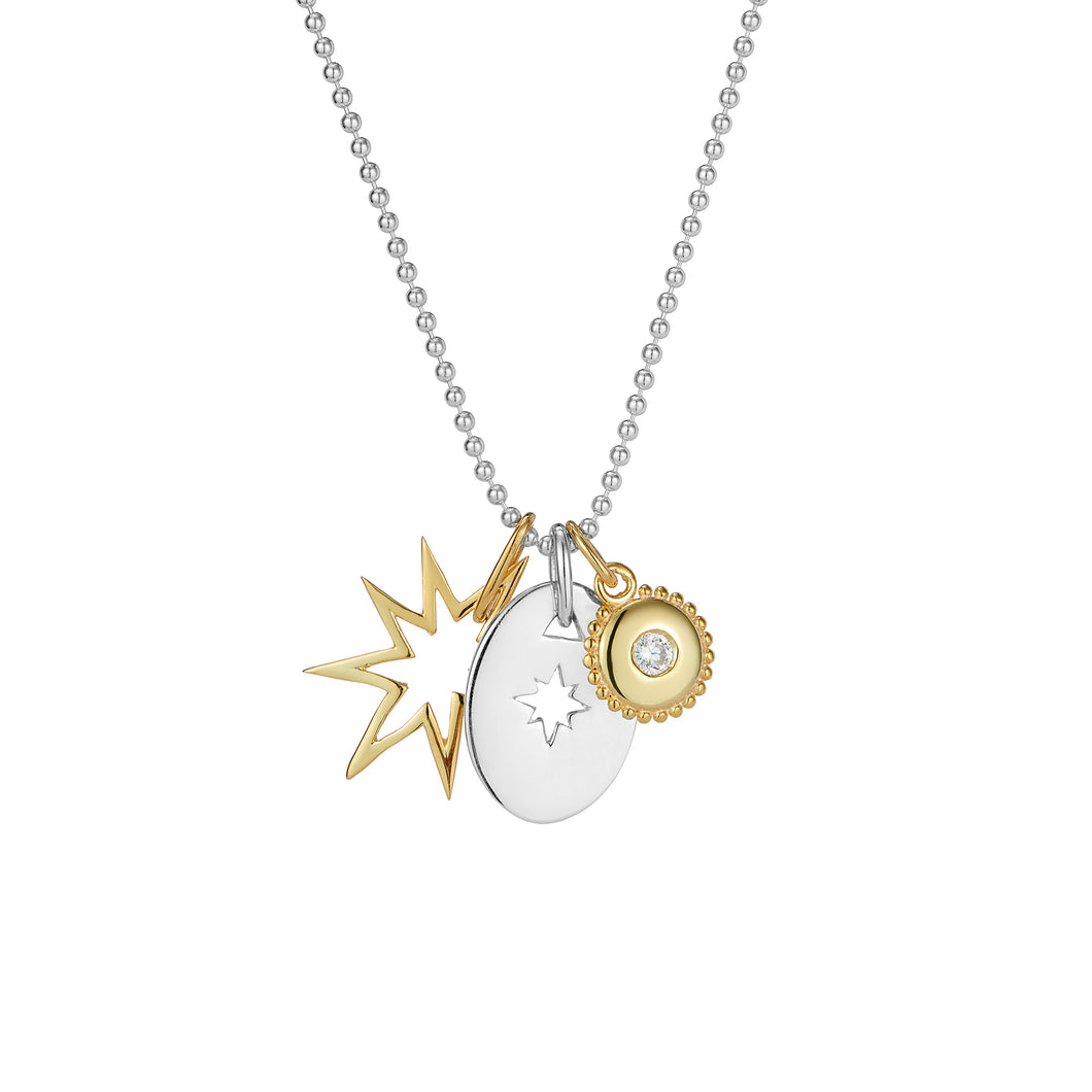 Gold star, silver disc and jewel charm pendant set