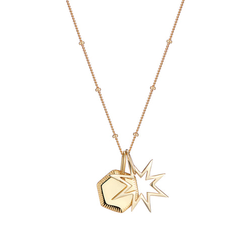 Star charm and engraved geometric disc pendant set on chain